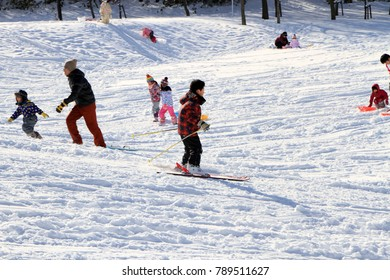 Children who plays with snow at the park in Sapporo on January 17, 2016