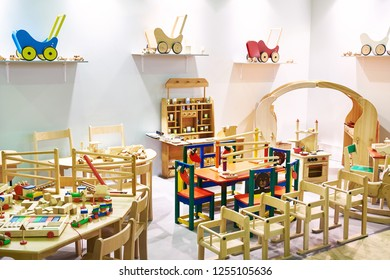 Children wooden furniture and toys in the store