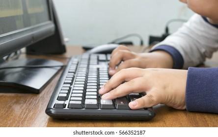 children work on a computer