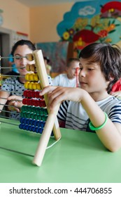 Children working with abacus in the classroom
