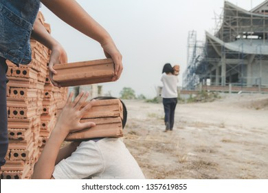 Children working at construction site for world day against child labour concept: