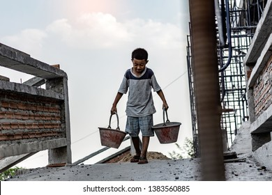 Children working at construction site for world day against child labor concept: