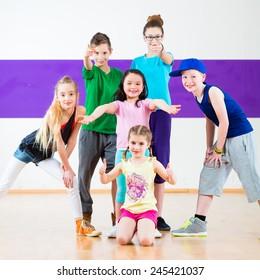 Children in zumba class dancing modern group choreography