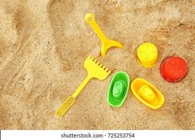 Children's beach toys on sand