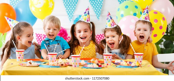 children's birthday. happy kids with cake and ballons