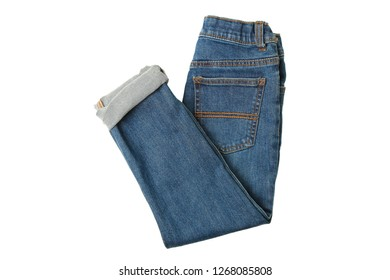 Children's blue jeans for boys isolated on white background. Top view.