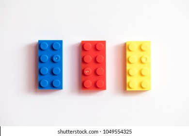 Childrens building blocks similar to legos, yellow red and blue