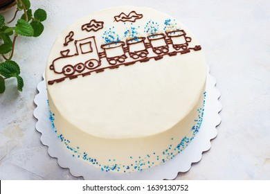 children's cake with the image of a steam locomotive on the table, a cake for the boy.