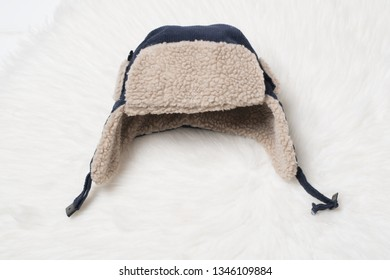 Children's cap with earflaps brown fur. Fashionable clothing concept