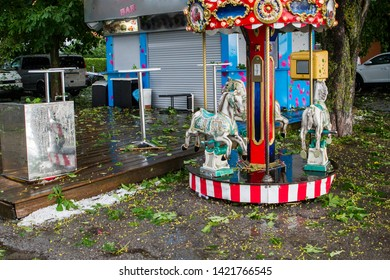 Children's carousel at the Ammersee in Bavaria after a heavy thunderstorm with a hailstorm