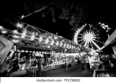 Children's Carousel at an amusement park in the evening and night illumination. amusement park at night. amusement park, picture for the background. vintage photo processing / black and white photo