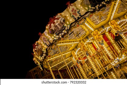 Children's Carousel at an amusement park in the evening and night illumination. amusement park at night. Outdoor vintage colorful carousel in the the city. Carousel detail. Retro carousel