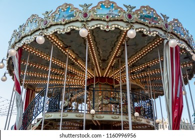 Children's carousel in the center of Moscow. Two-storey carousel with horses. Carousel with animals