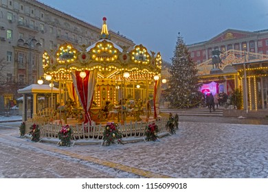 """Children's carousel at the Christmas Fair on Tverskaya Square. Traditional Moscow Festival """"Journey to Christmas"""", Moscow, Russia, Decembwe 2017."""