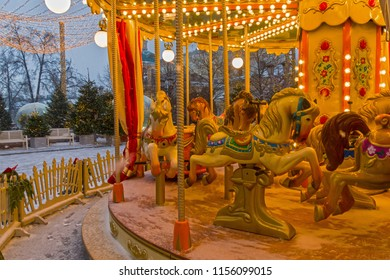 """Children's carousel at the Christmas Fair. Traditional Moscow Festival """"Journey to Christmas"""", Moscow, Russia, Decembwe 2017."""