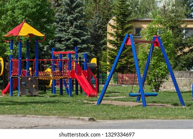 a children's climbing frame and a swing on the playground