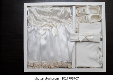 Children's clothing, dress, shoes, on a dark background