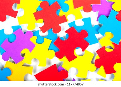 Children's color cardboard puzzles on a white background