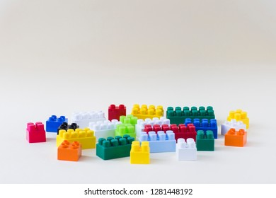 Children's colored cubes  on a light yellow background