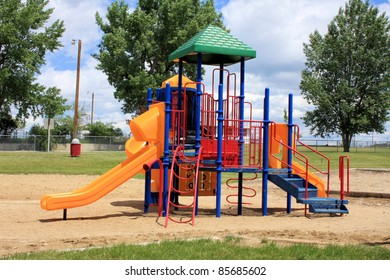Children's colorful playground equipment in a city or rural park