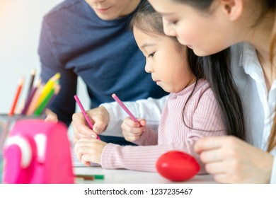 children's creativity. happy family mother father with child draw and paint is a leisure activity.