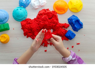 Children's creativity. Kinetic sand games for child development at home. Sand therapy. Development of concept of fine motor skills. The concept of creative play. Selective focus.