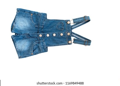 Children's denim shorts (toddler, blue jean overall) with suspenders isolate on white background for spring and summer wardrobe/ Baby clothes/ Close-up/ Top view/ Flat lay