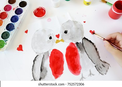 The children's drawing of the kissing birdies on white paper for St. Valentine's Day