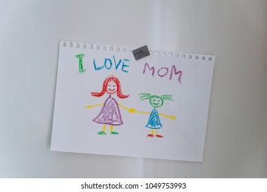 children's drawing on fridge. I love mom.