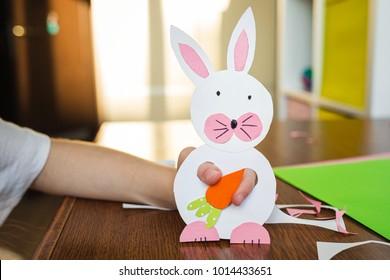 Children's easter gift - bunny with carrot. children's creativity, needlework, crafts for children. carrots in hand