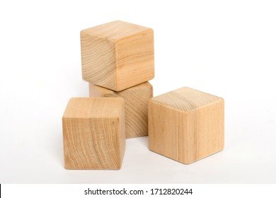 children's eco toys for toddlers, wooden cube isolated on a white background, the development of fine motor skills and thinking in children