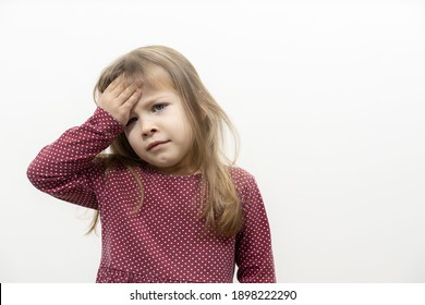 children's emotions. the little girl has a headache. the child holds on to the forehead. mock up with copy space