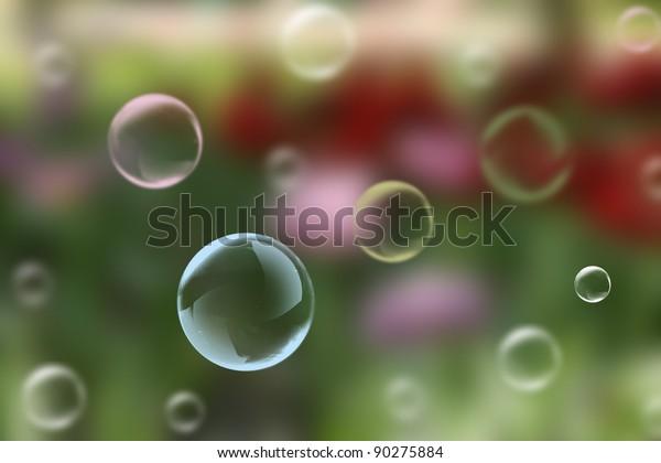 A children's entertainment. Soap bubbles on a multicolored background