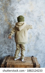 children's fashion, baby dancing in a hoodie suit, hoodies, khaki clothing, back, back view
