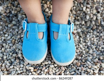 Children's feet in blue shoes