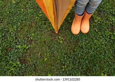 Children's feet wearing rain boots