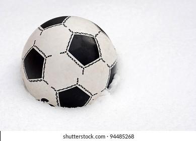 Children's football ball on the snow