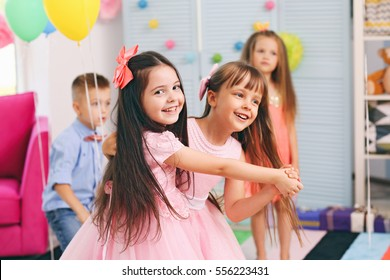 Children's funny birthday party in decorated room