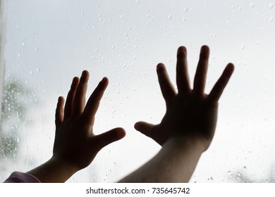 children's handles on the glass with drops