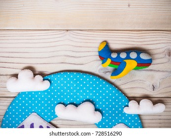 Children's handmade toys from felt on the wooden background