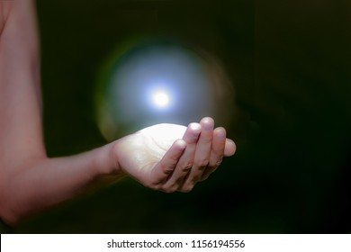 children's hands hold a bright glowing sphere, the universe, the whole world, the atom in the hands, magic, energy, the soul, taking care of the world