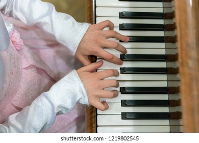 Children's hands on piano keys. children's hands are playing the piano.