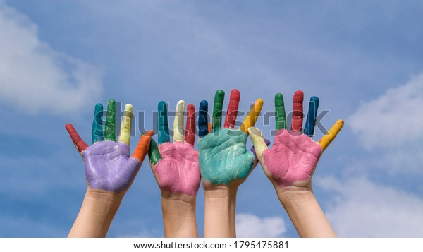 childrens-hands-painted-multicolored-pai