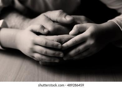 children's hands and the hands of parents.