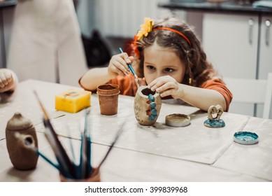 children's hands sculpts clay crafts pottery school