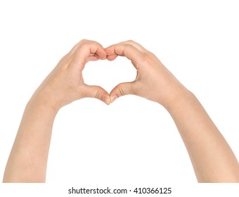 Children's hands show heart. Isolated on white.