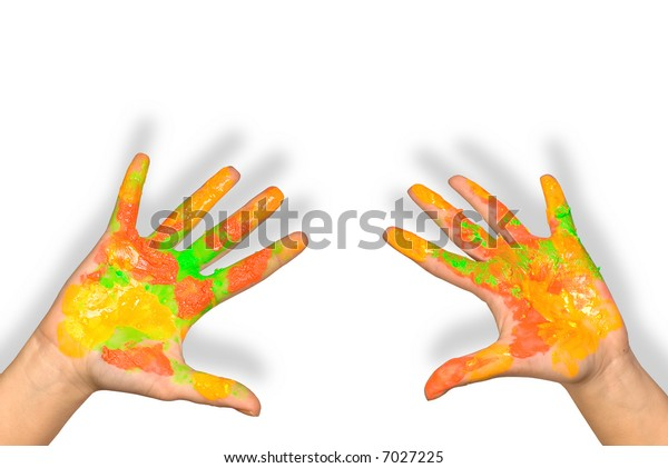 Children's hands soiled with paints on a white background
