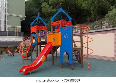 Children's hill in a house court yard. Urban