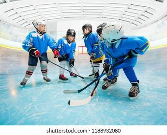 Children's ice hockey team practicing on rink