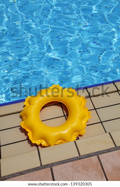 children's inflatable circle on the edge of the pool